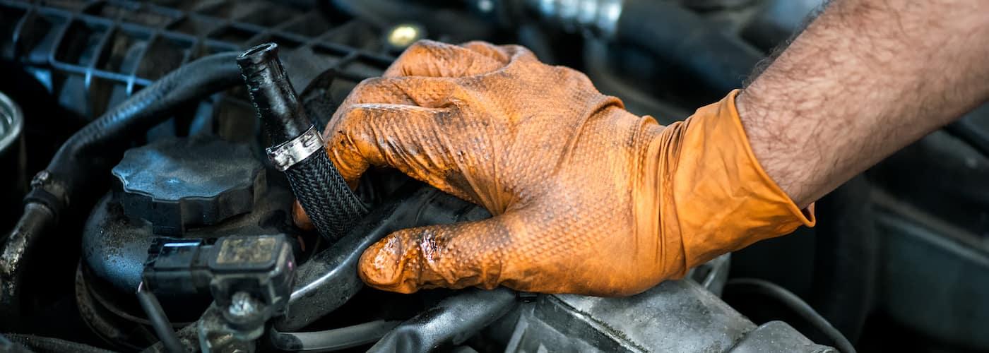 mechanic putting hand on engine
