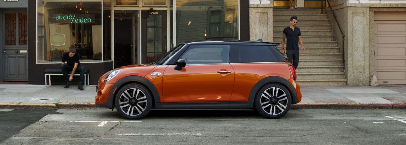 2020 red mini cooper 2 door hardtop parked outside with man walking to car