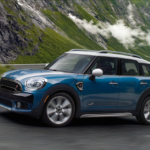 2020 mini cooper countryman blue exterior driving down beautiful road