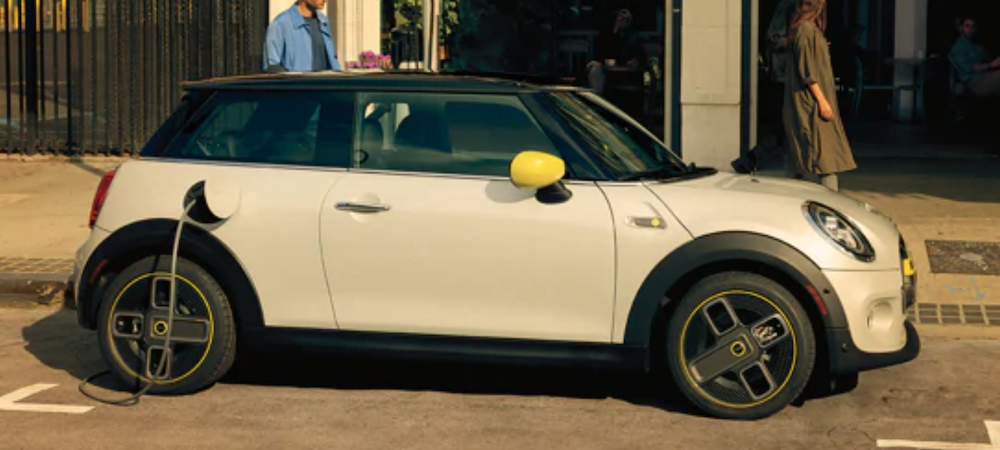 2021 mini cooper electric white exterior parked outside on curb charging