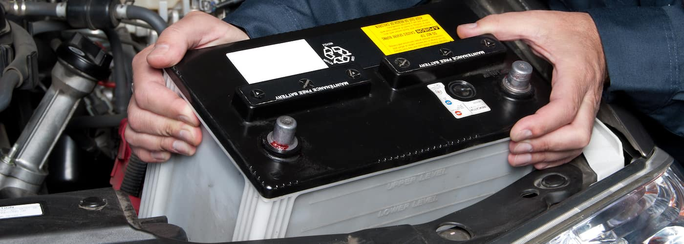 mechanic replacing car battery close up