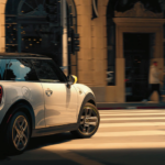 2021 mini electric driving around corner side view