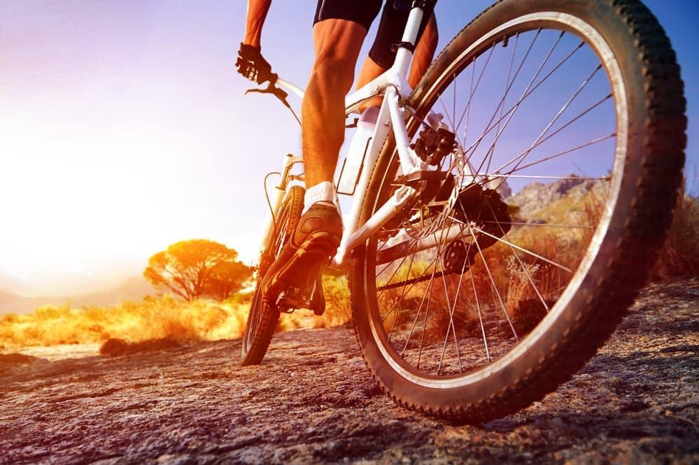 Cyclist rides bike trail