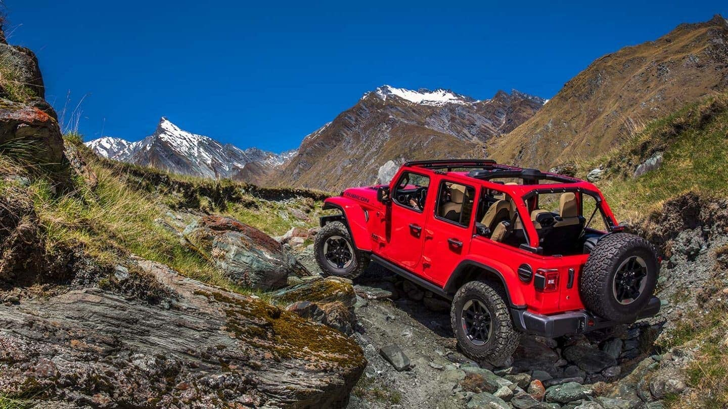 2020 Jeep Wrangler Rubicon driving up rocks