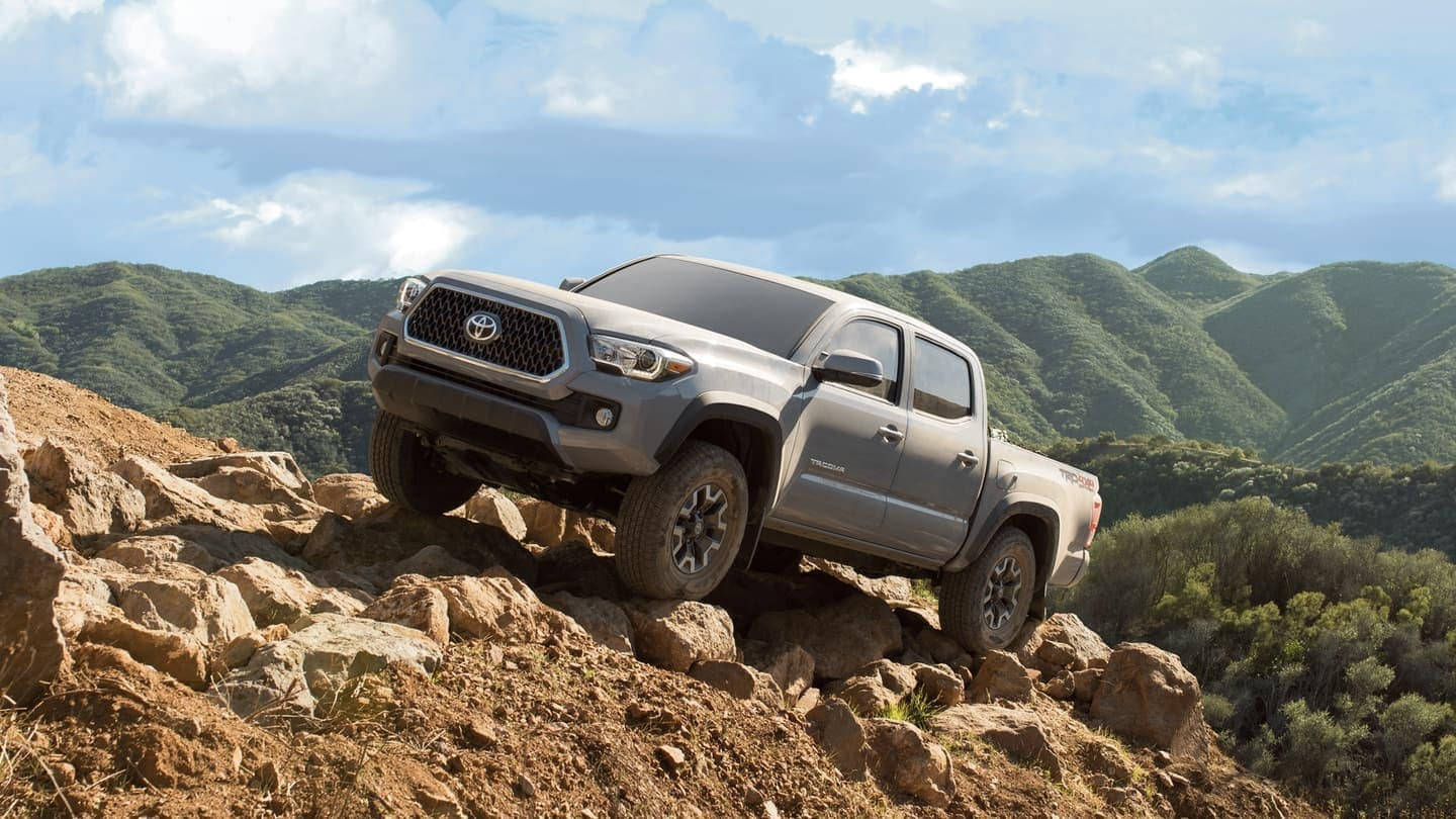 2019 Toyota Tacoma driving up rock face