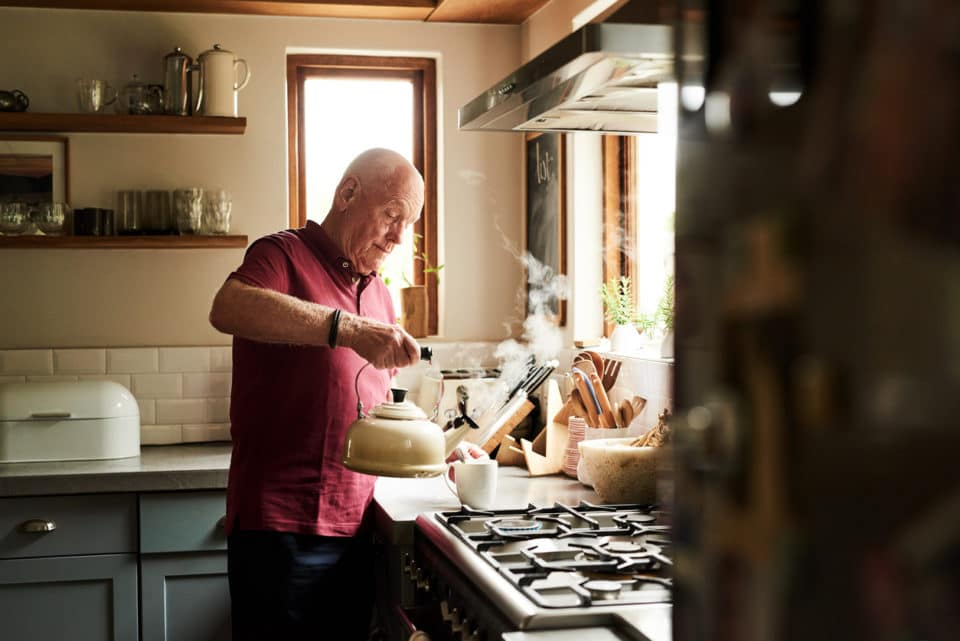 Cropped shot of a senior man preparing a hot beverage at home