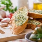 Garlic bread on cutting board