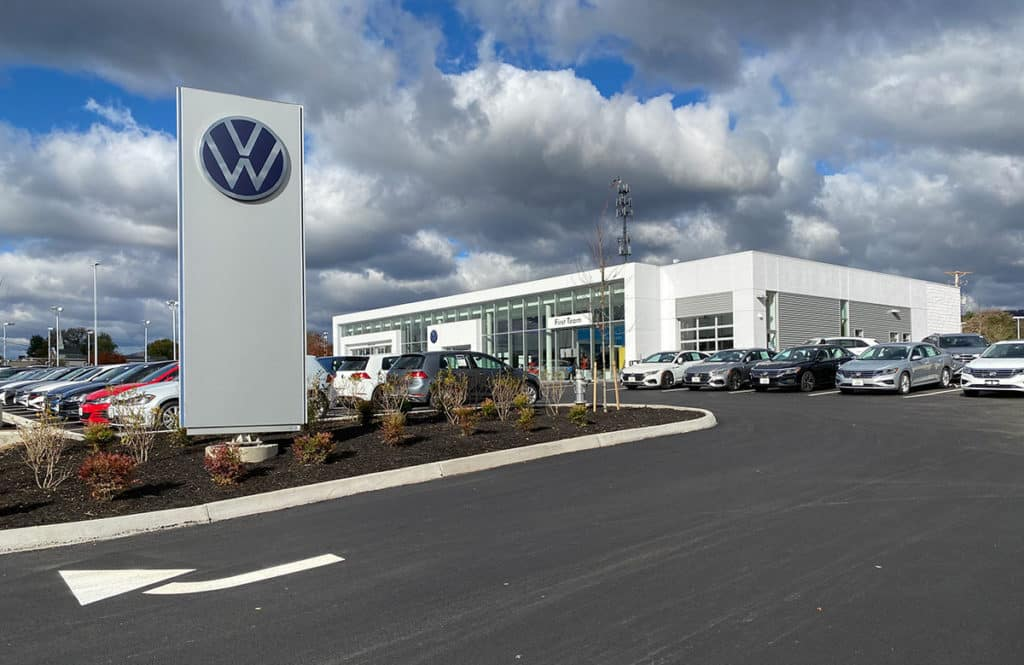 VW-building-New-opening-day-with-sign