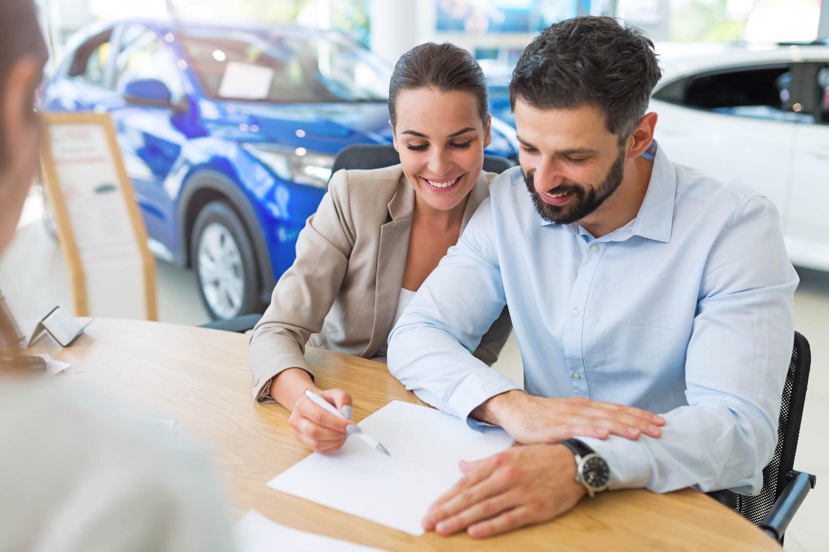 Couple signing a car contract
