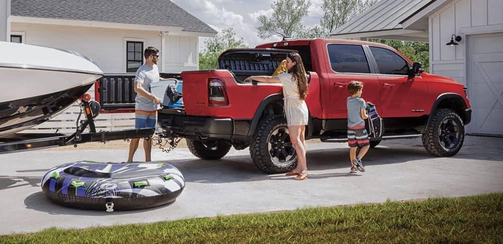 Family loading up red 2020 Ram 1500