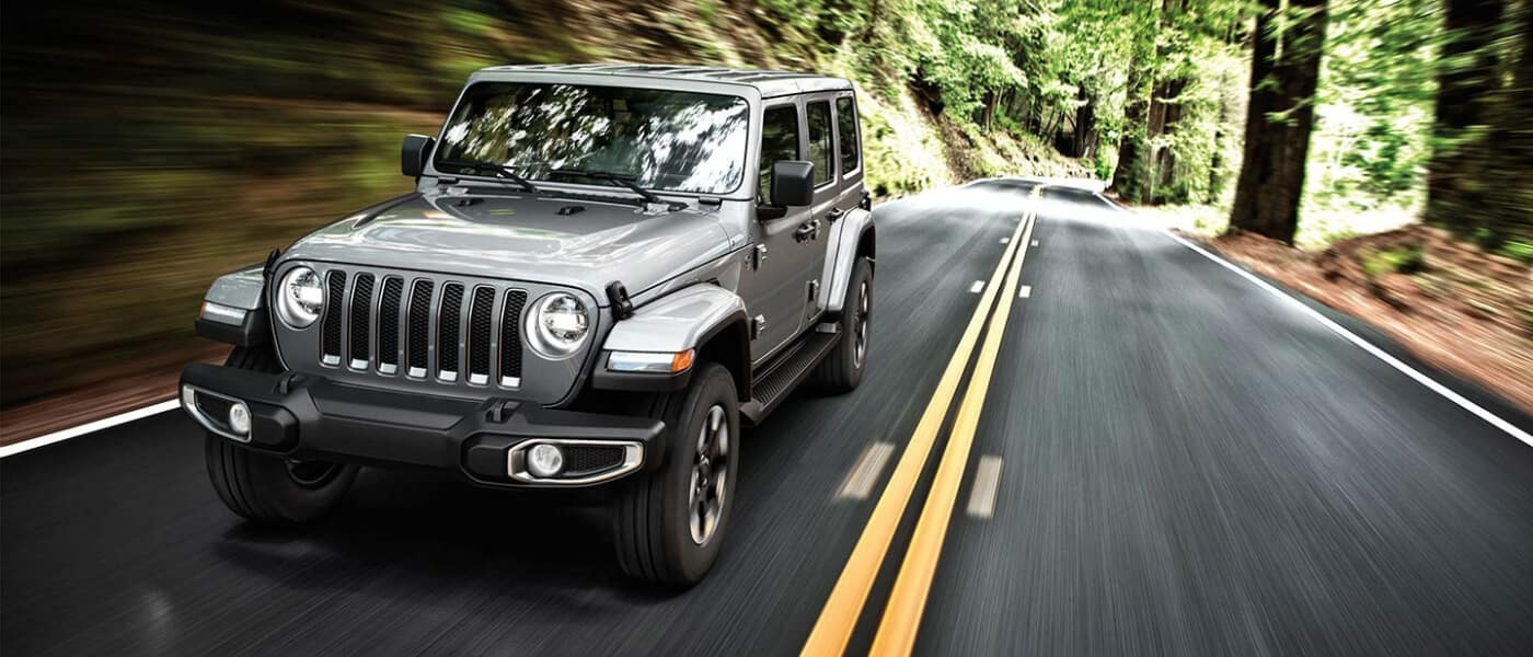 2020 Jeep Wrangler driving down a forest road