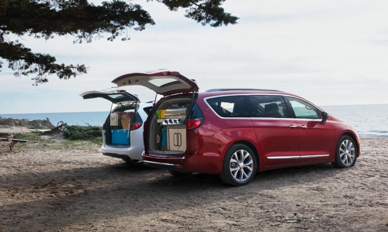 Two 2020 Chrylser Pacifica parked by a lake