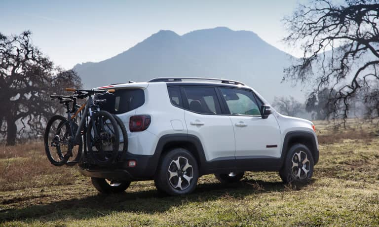 2020 Jeep Renegade parked in a field with bike rack