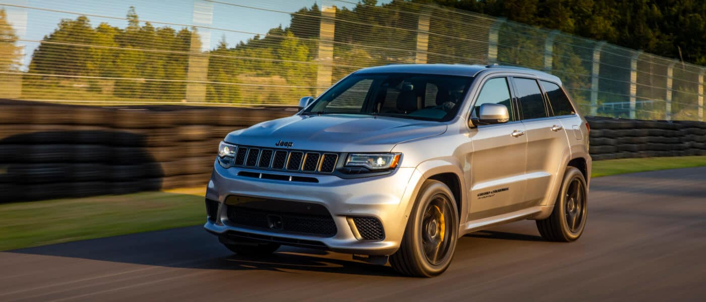 2021 Jeep Grand Cherokee driving on a track exterior view