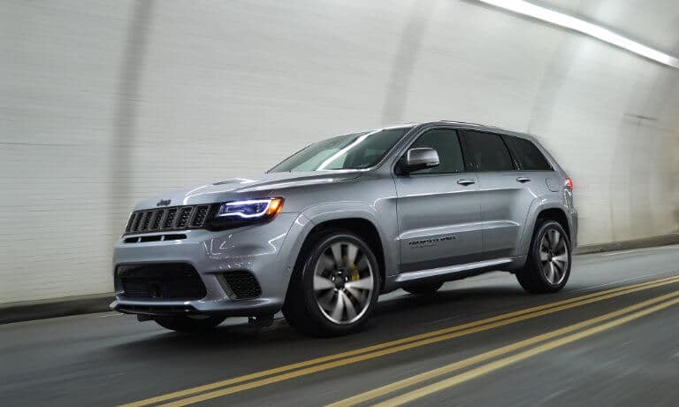 2021 Jeep Grand Cherokee driving throgh a tunnel