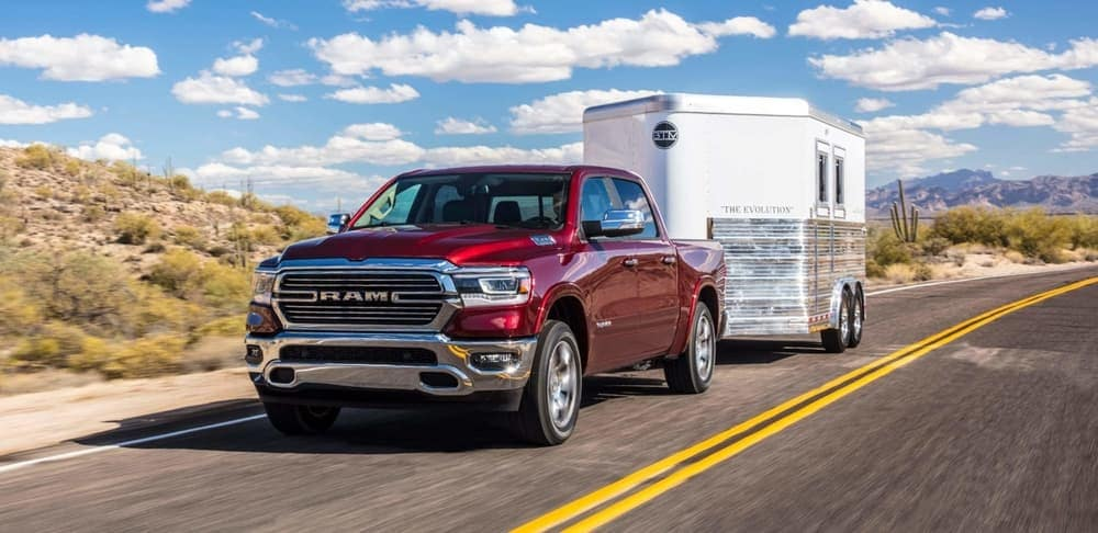 2019 Ram 1500 towing trailer on road