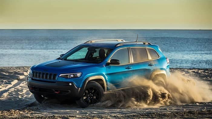 Jeep Cherokee Driving In Sand