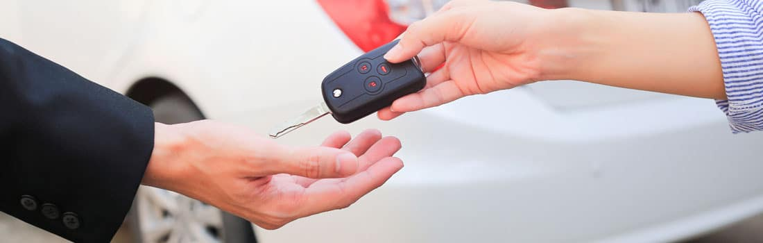 handing over the keys to the car