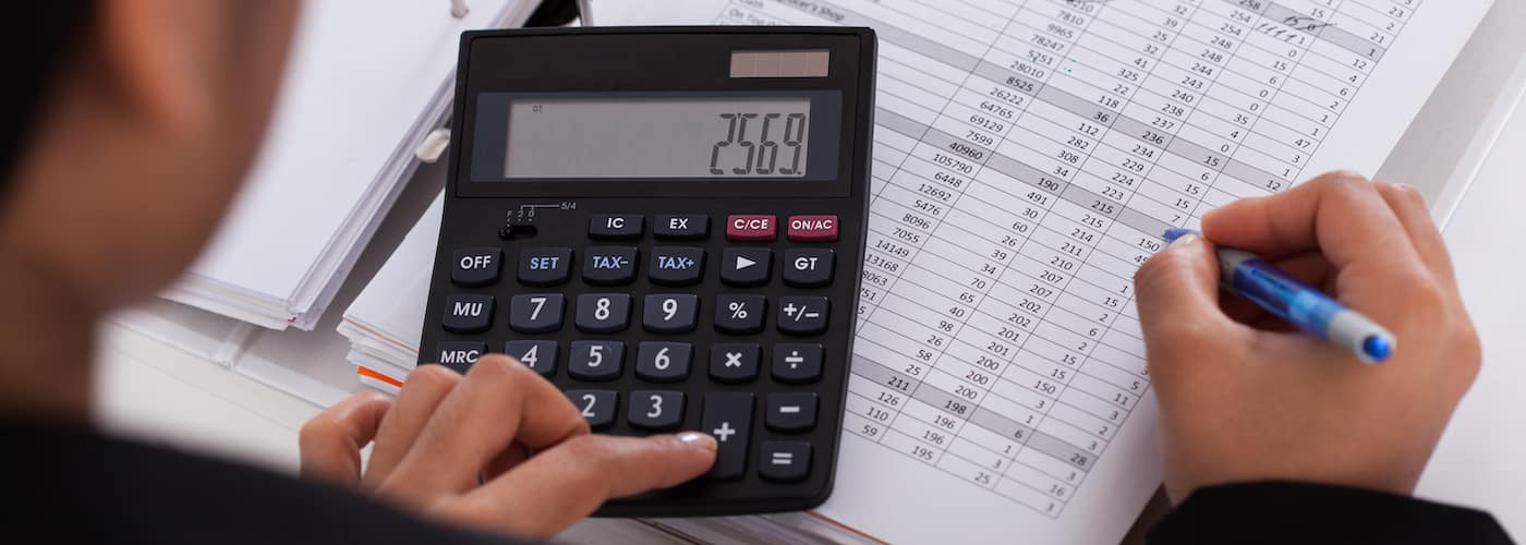 woman calculating finances close up