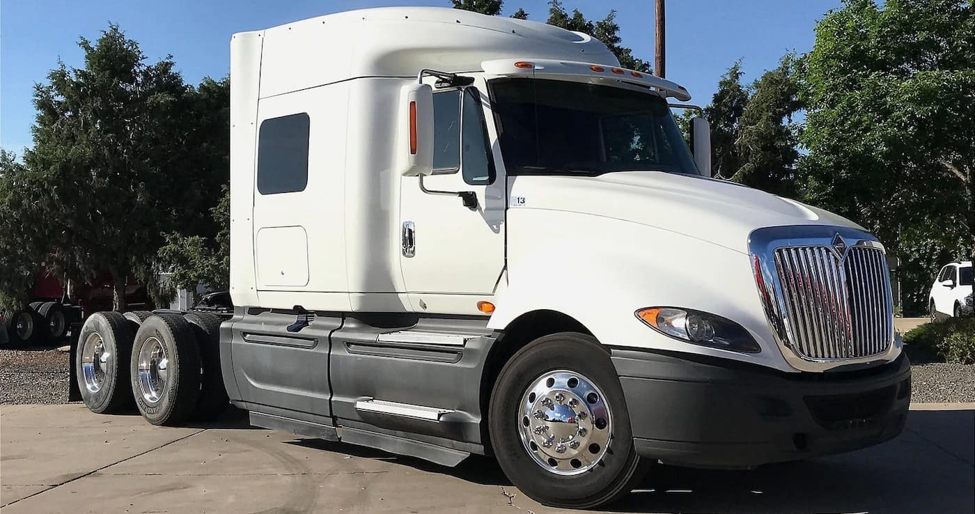 pre-owned 2015 international prostar 122 6x4 white exterior sleeper parked in lot