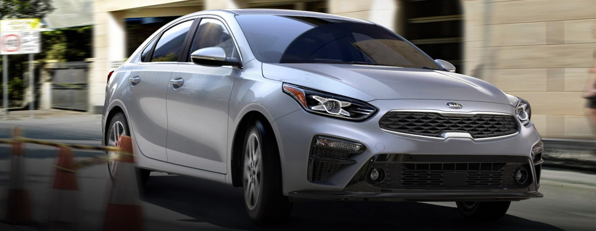 Kia_Forte_Silver_Driving_In_CIty