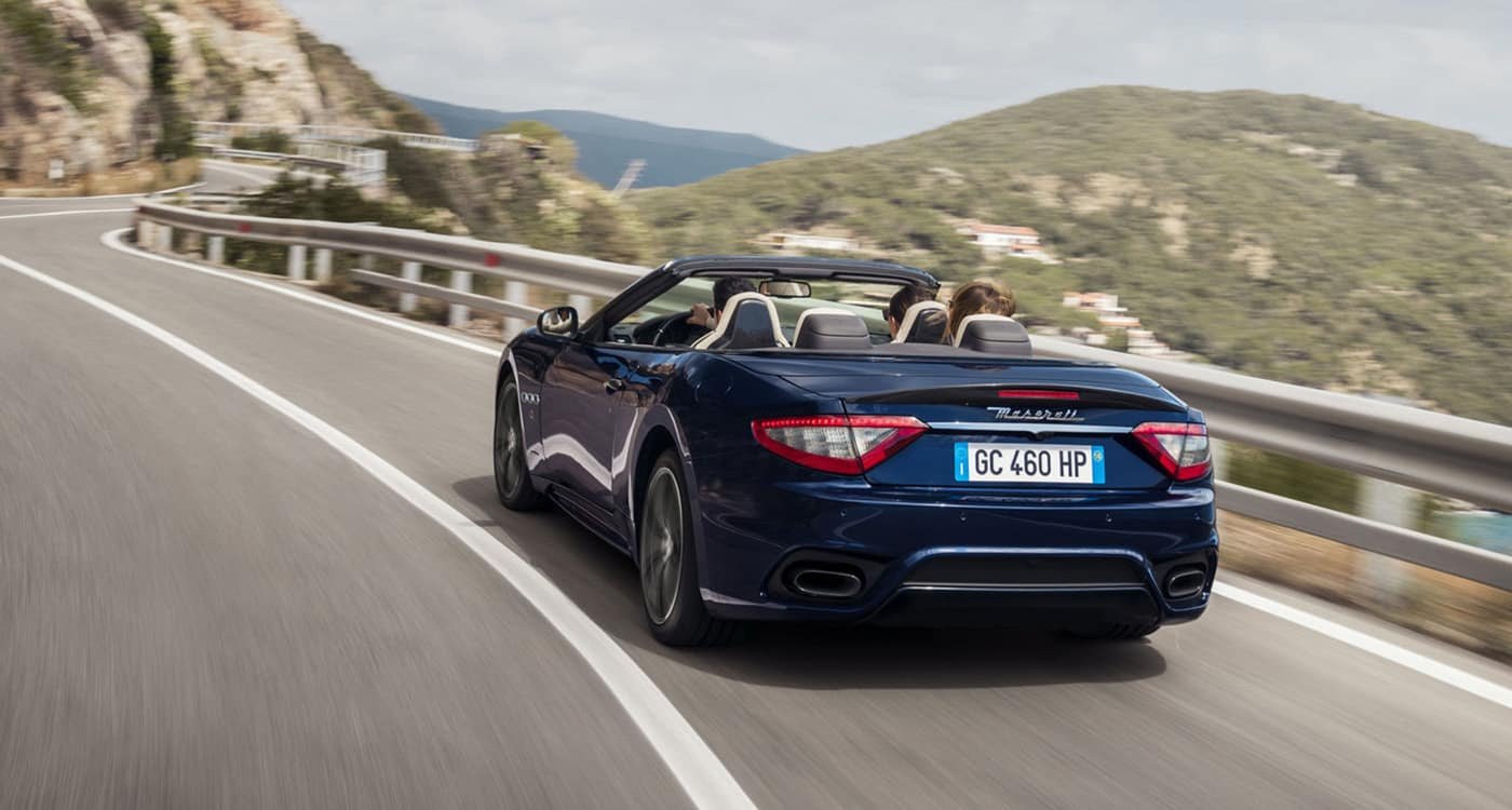 2019 Maserati navy car driving in the mountains