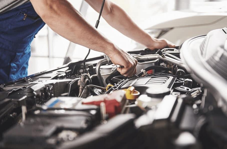 Technician Working on Engine
