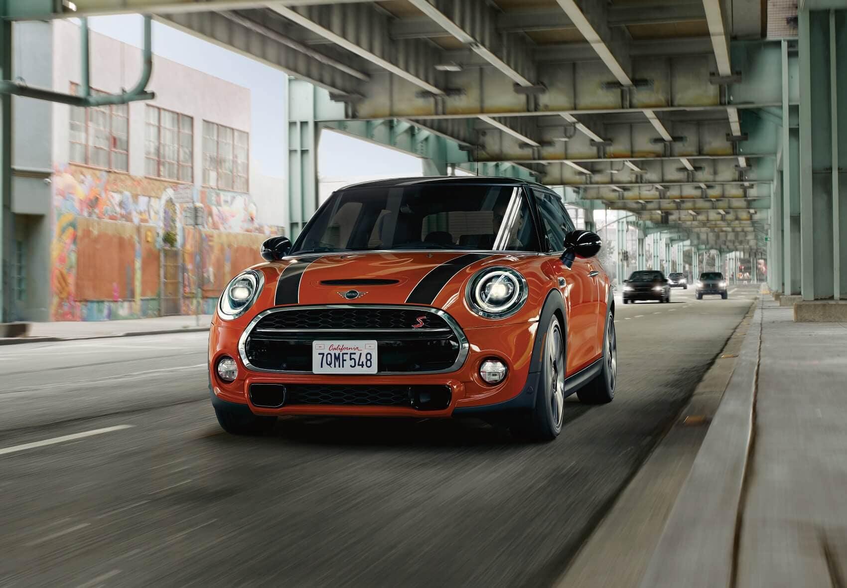Orange Mini Cooper Driving Manhattan NY