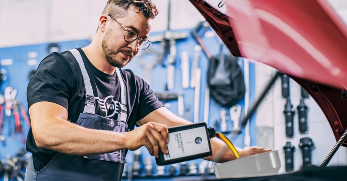 MINI technician providing oil change