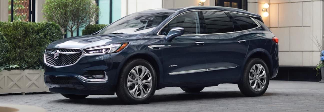 A Buick Enclave Avenir trim parked in a driveway