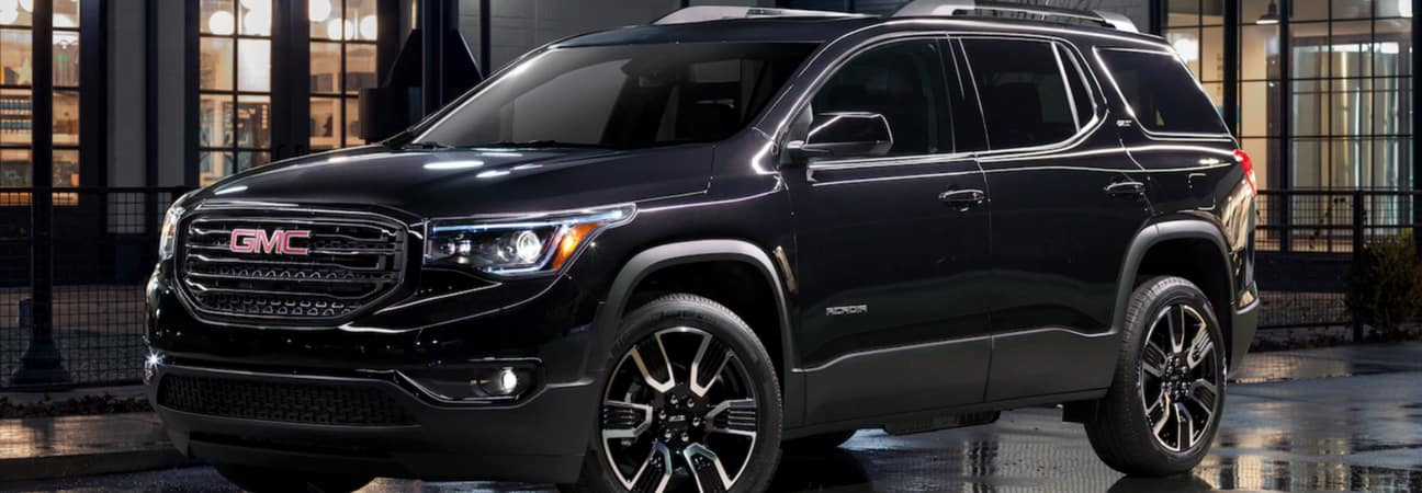 The 2019 GMC Acadia parked in front of a building