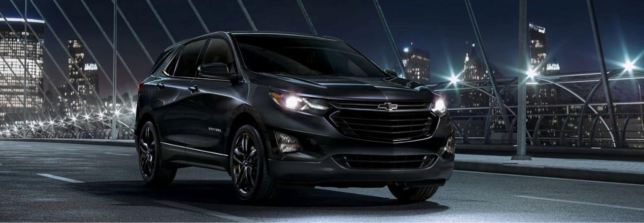 2020 chevy equinox driving through the city at night