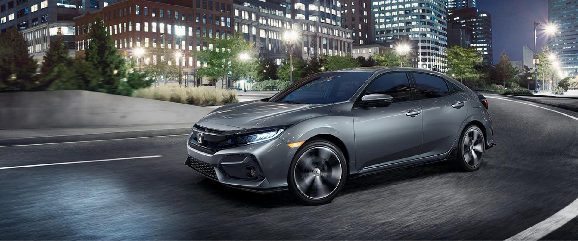 Honda_Civic_Hatchback_Driving_In_City_At_Night