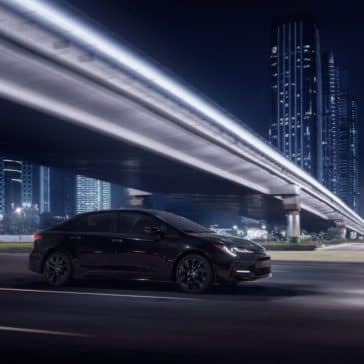 Toyota_Corolla_Driving_In_City_At_Night