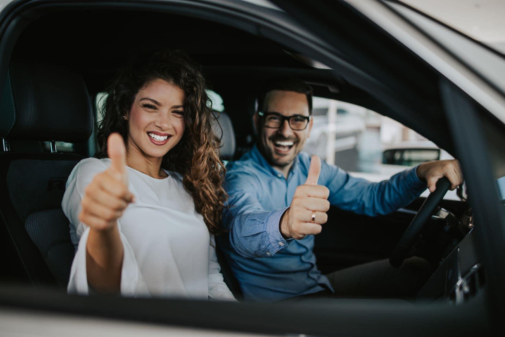 A couple inside a rental car