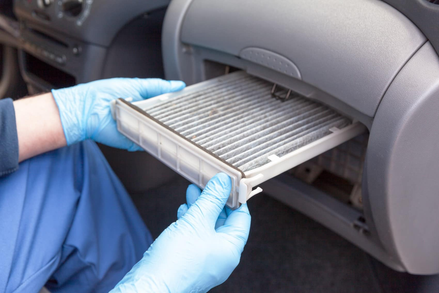 Technician changing the cabin air filter