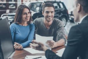 Employee and Customers in dealership near Philadelphia PA