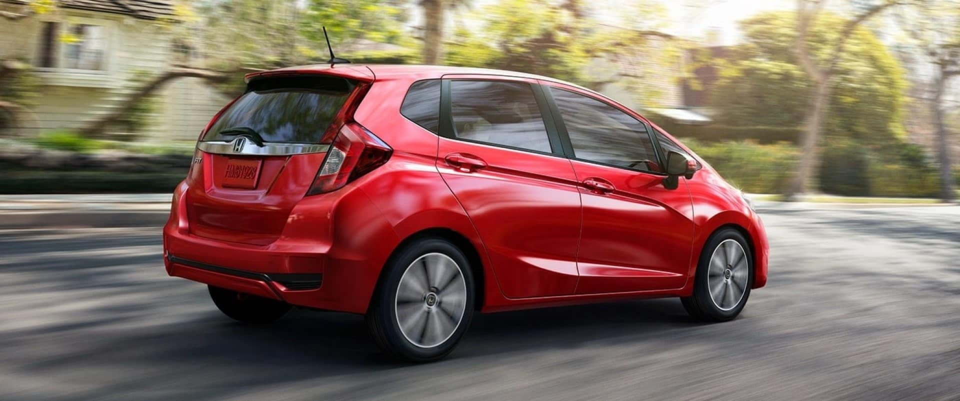 Honda_Fit_Red_Driving_In_City