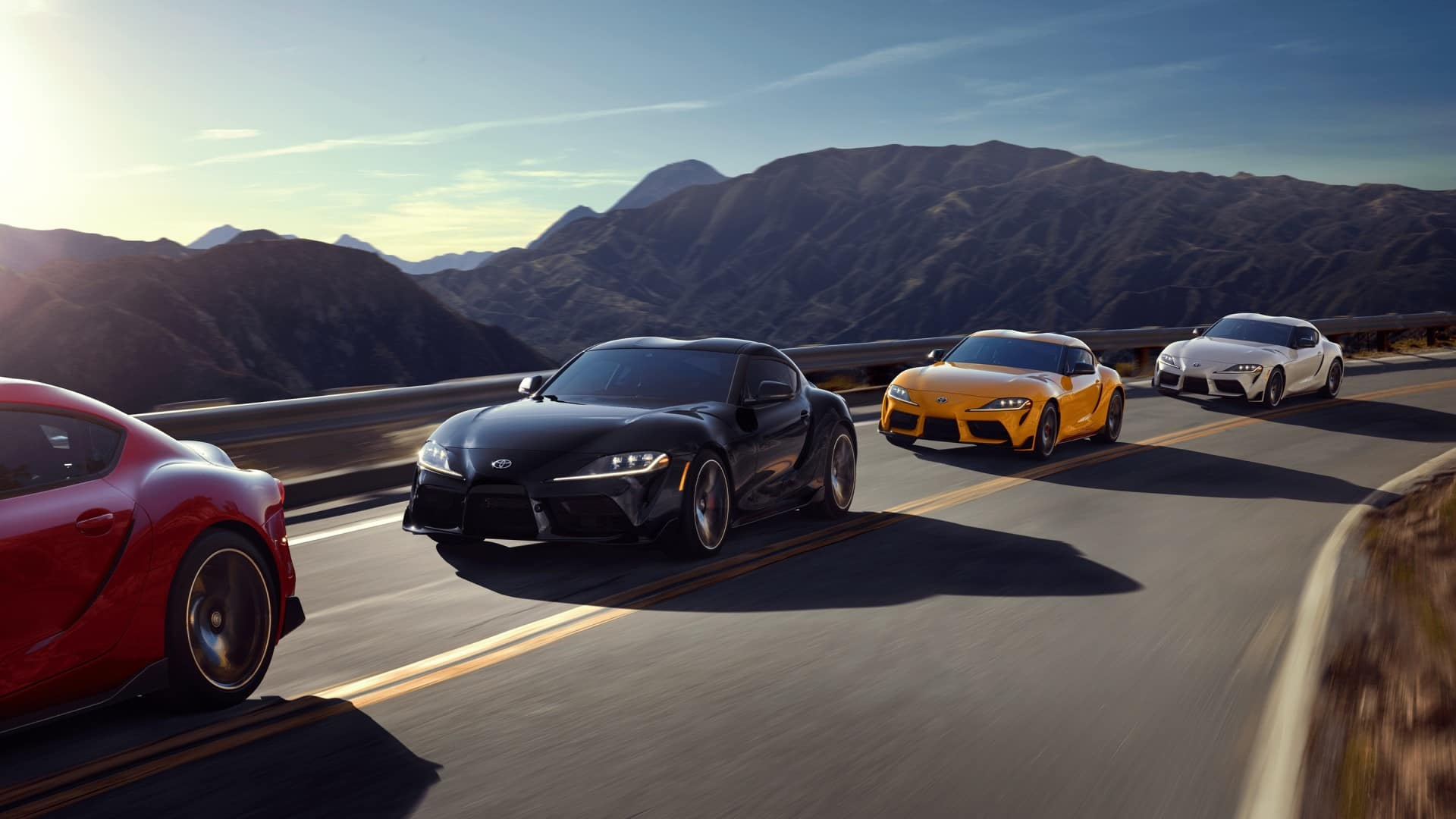 Toyota_Supra_Driving_In_A_Group