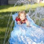 child riding down slip n slide