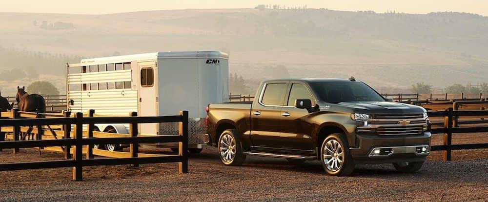 A 2020 Chevy Silverado 1500 towing a horse trailer