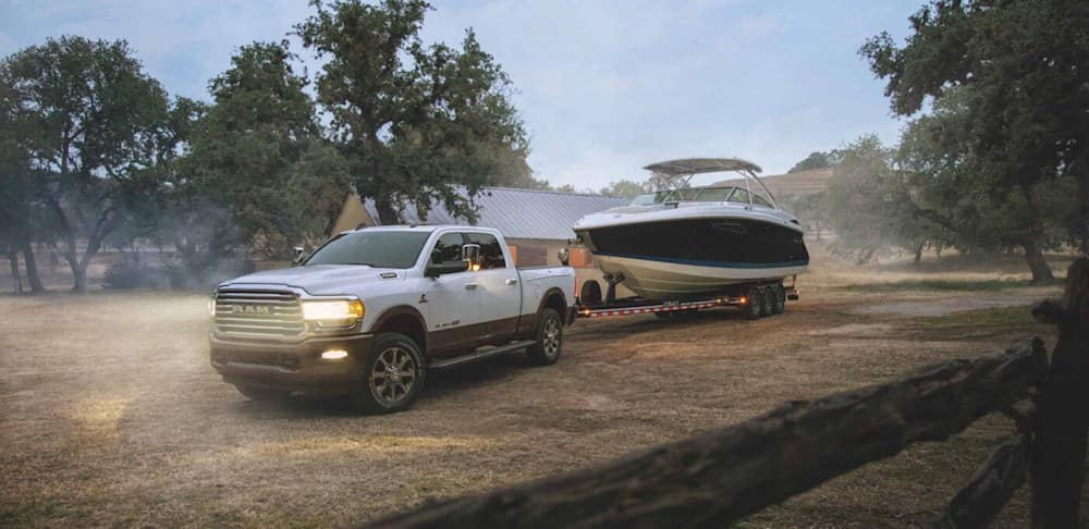 A 2020 RAM 2500 towing a large boat