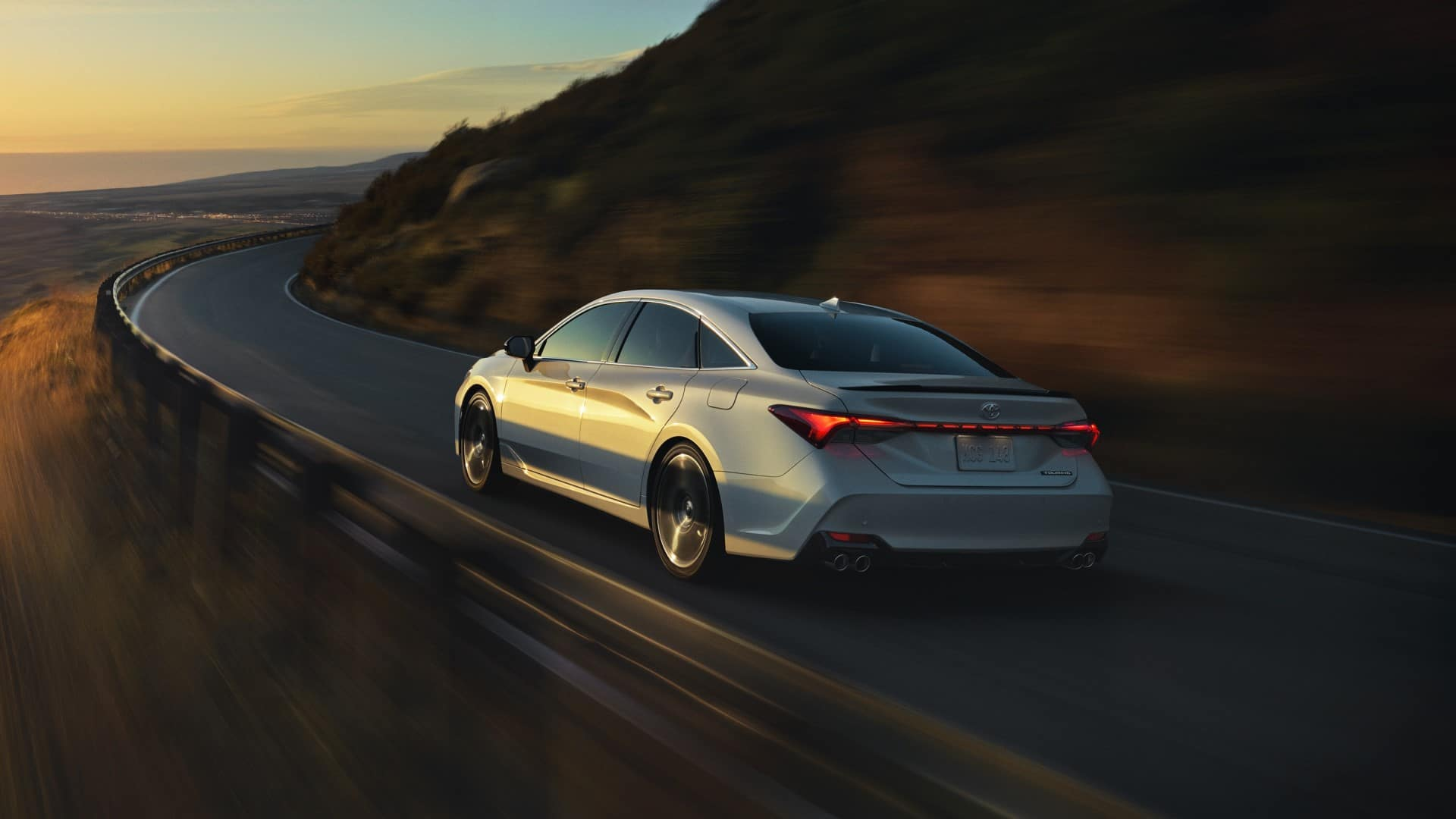 Toyota_Avalon_Driving_Rear_View