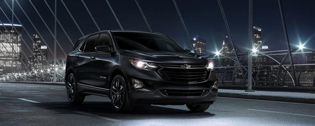 2020 Chevrolet Equinox driving in city at night