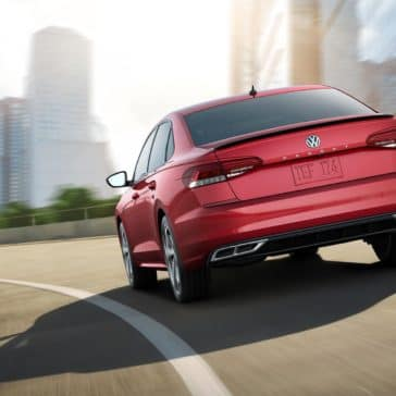 VW_Passat_Red_Driving_Rear