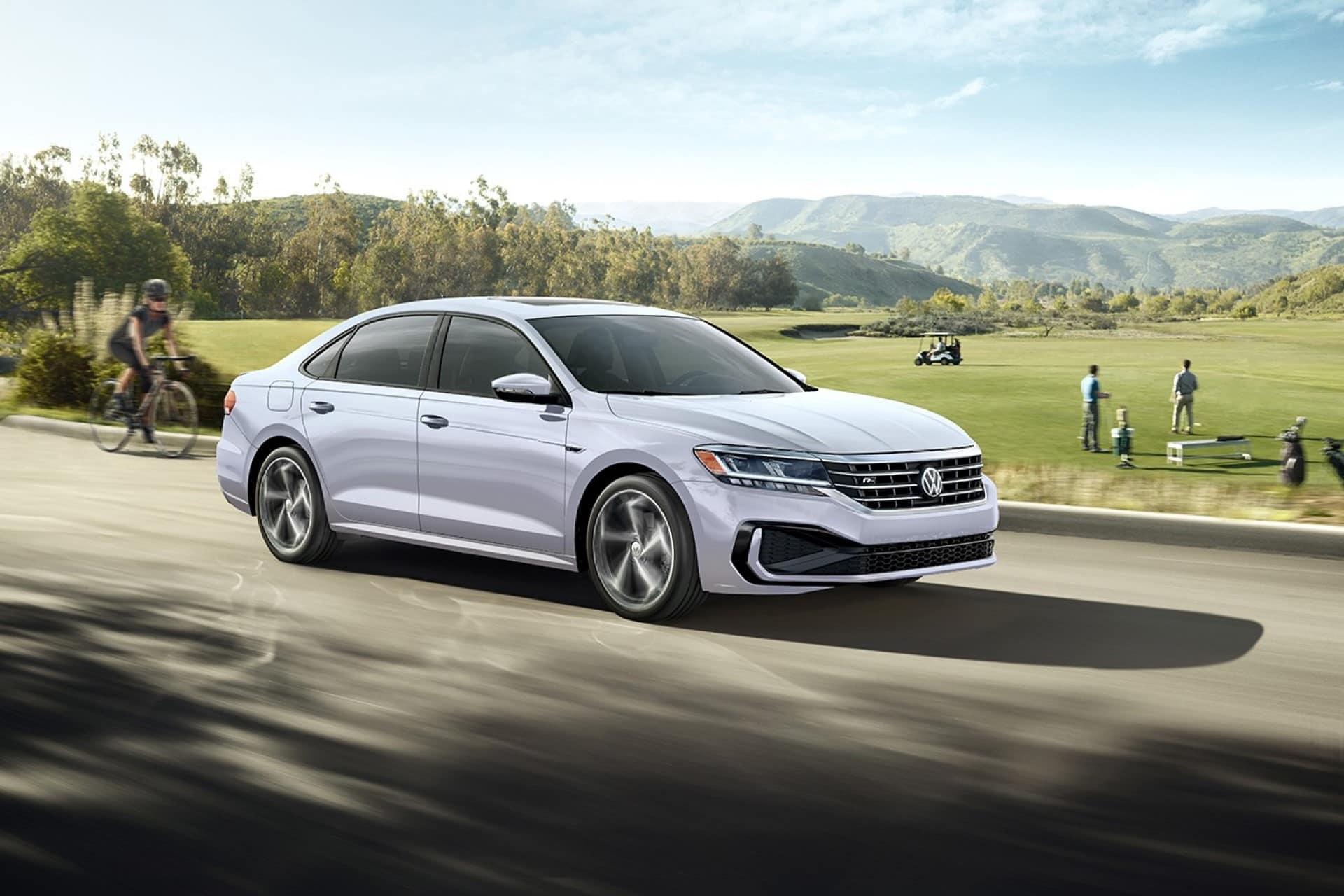 VW_Passat_Silver_Driving_Suburban