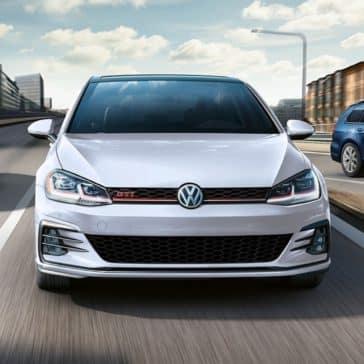 Volkswagen_Golf_GTI_Driving_In_City_Head_On
