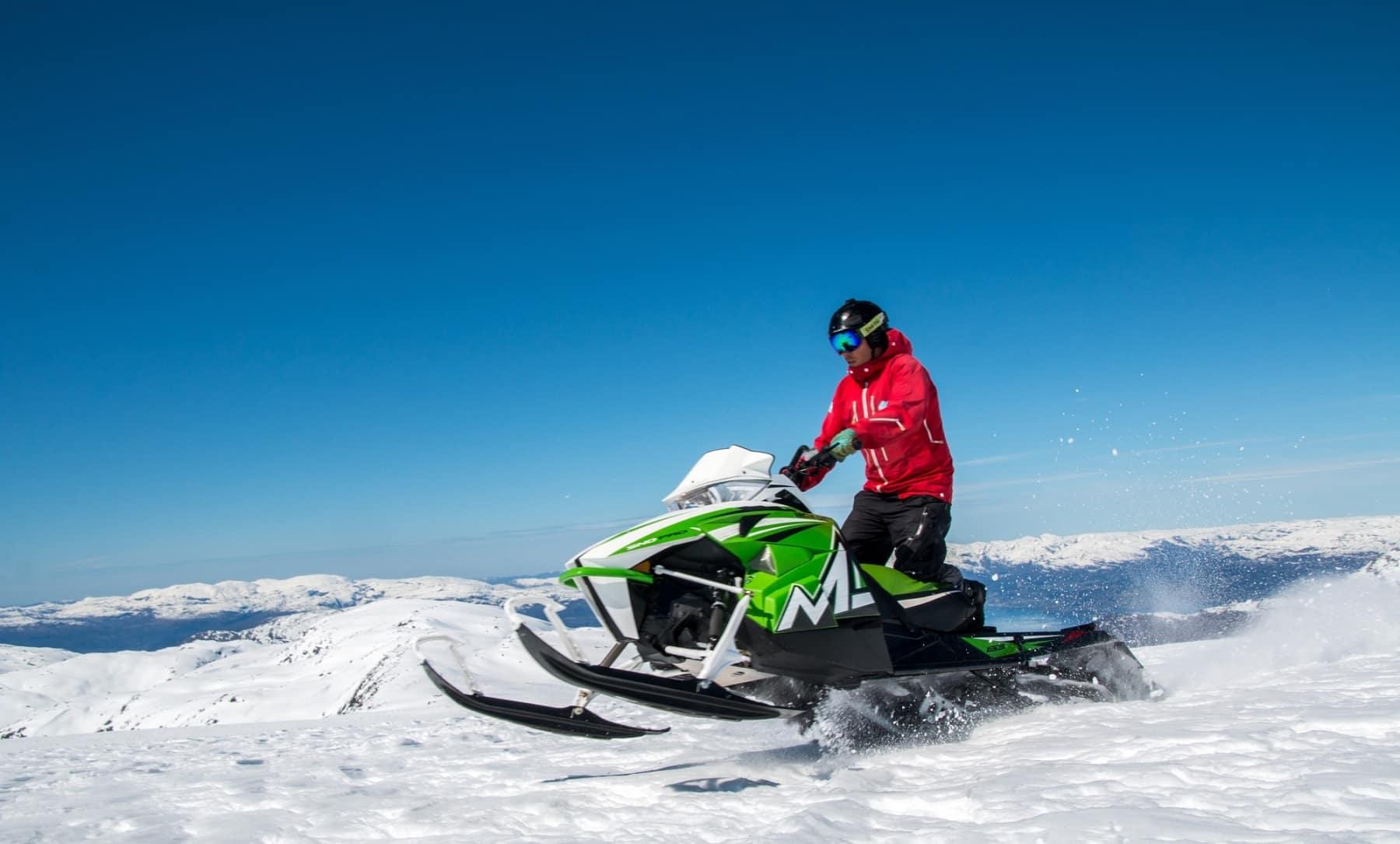 riding a snowmobile