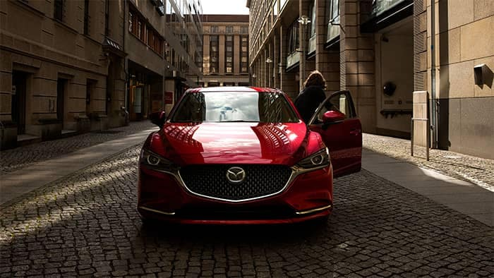 Front End View of Red Mazda6 in Alley