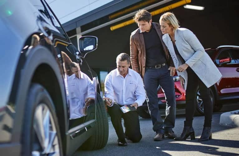 Mazda Service Rep Talking to Customer